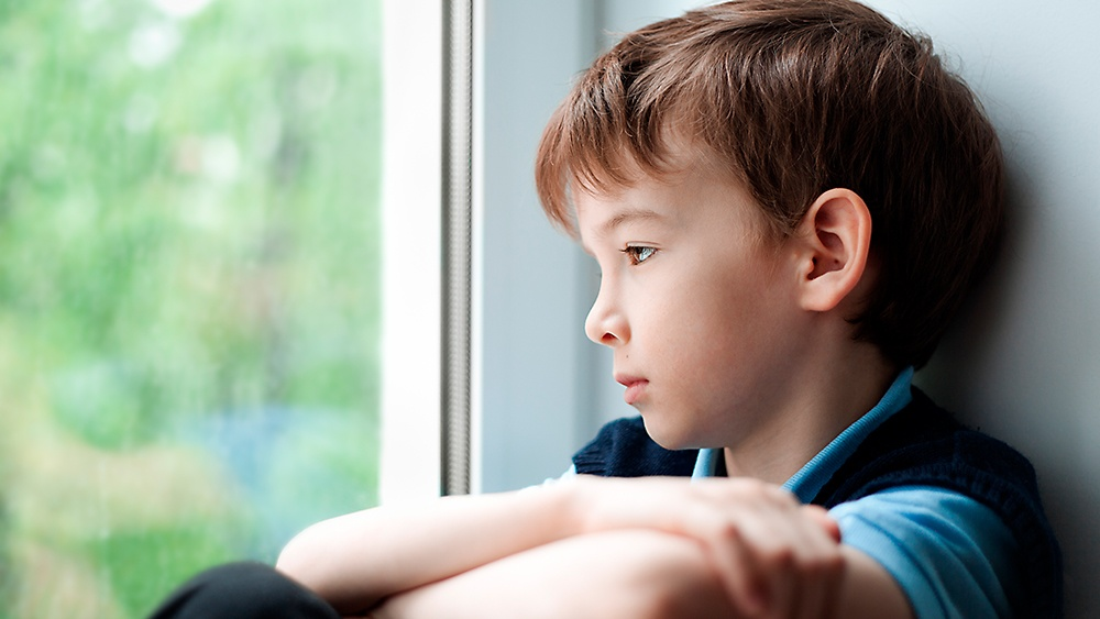 children-and-TAI-bowel-dysfunction-unhappy-child-gazing-out-of-window.jpg